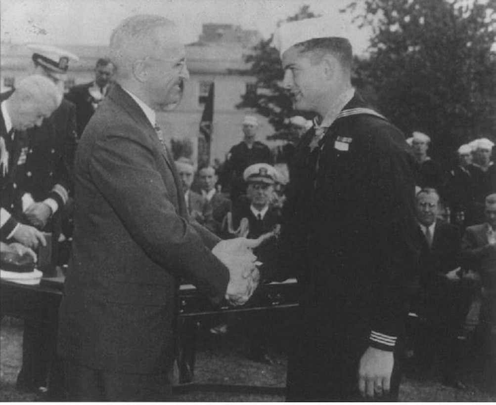 An old photograph shows when corpsman Robert E. Bush received the Medal of Honor from President Harry S. Truman Oct. 5, 1945 in Washington.