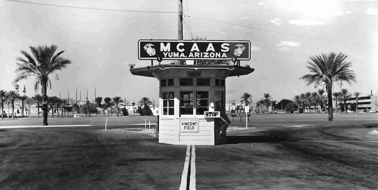 "Approximately 10 months after the Marine Corps took over what was Vincent Air Force Base, a sign for Vincent Field remains on the main gate of the Marine Auxiliary Air Station Yuma on Sept. 26, 1959. The station dropped the word ""auxiliary"" on July 20, 1962. One of the first four Marines assigned to the air station in 1958 as part of the transition team, Reg Garavito, returned to Yuma Jan. 12, 2010, and donated the photo to the station."