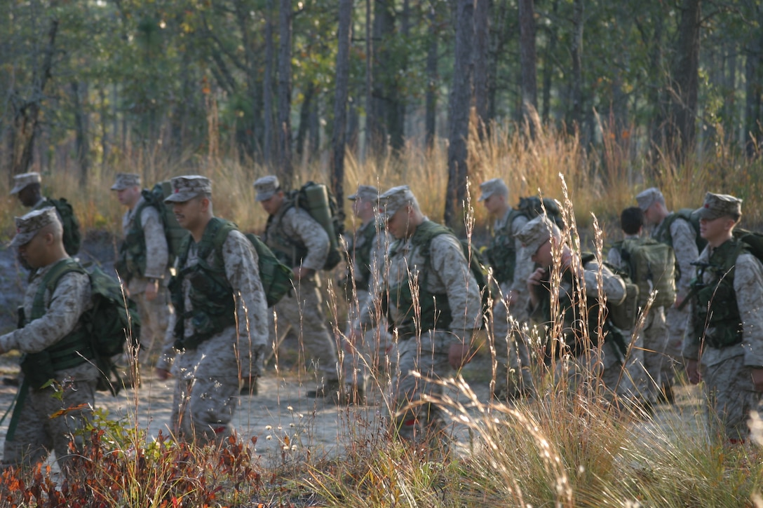 Cpl. James R. Keener, 26 MEU, S6, looks at the rest of the obstacle he and his team are trying to traverse during the Litter Bearer training held March 20.