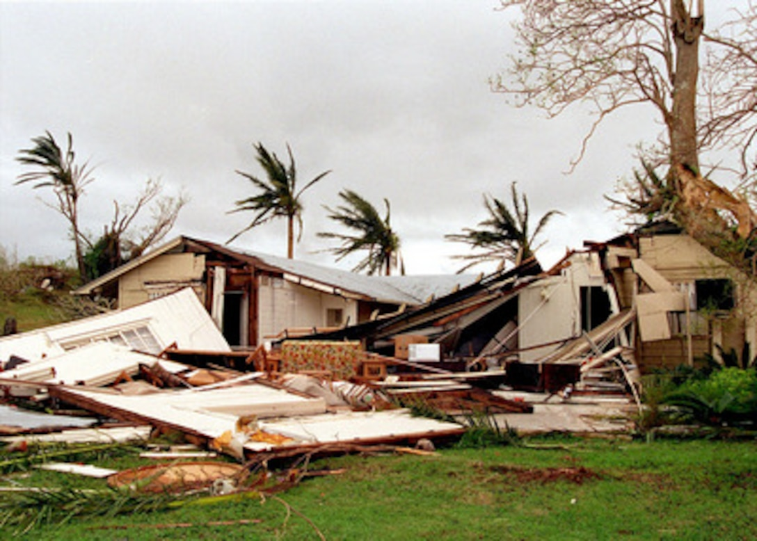 Military quarters in the Nimitz Hill housing area near Naval Station Marianas, Guam, lie smashed in the aftermath of super typhoon Paka on Dec. 17, 1997. Super typhoon Paka hit the island the night before with average sustained winds of 175 mph. One wind gust recorded at nearby Anderson Air Force Base was the strongest ever recorded on earth at 236 mph.