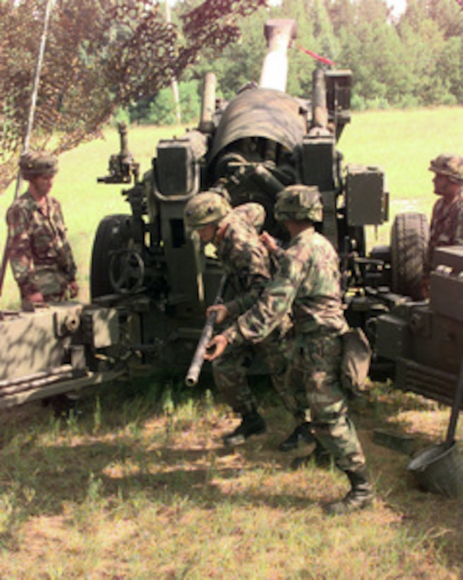 Soldiers from Charlie Company prepare to fire a 155mm howitzer