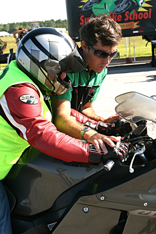 Dylan R. Code (right), an instructor and program operator with the California Superbike School, corrects Howard Protrovsky, a civilian worker with the Marine Corps Combat Service Support School, on proper techniques of motorcycle steering here Sept. 8. The two-day Advanced Motorcycle Operator School course focused on different skills related to steering, braking, traction and increasing