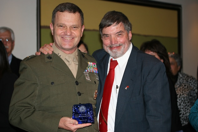 The former commanding general of Marine Corps Installations-West, Maj. Gen. Michael R. Lehnert, was honored for his leadership in the protection and restoration of America's endangered wildlife at the Endangered Species Coalition's Fall Celebration in Georgetown Nov. 19. Lehnert was presented the Champion Award for Habitat Protection in recognition of his environmental conservation efforts and his enthusiasm with restoring endangered species and protecting habitat on military bases. ::r::::n::