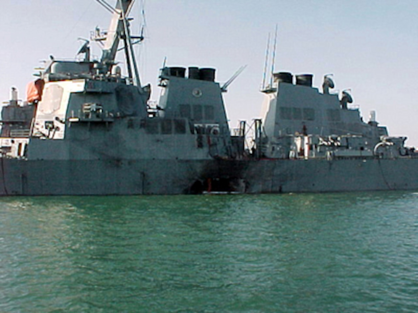 Port side view showing the damage sustained by the Arleigh Burke class guided missile destroyer USS Cole (DDG 67) on October 12, 2000, after a suspected terrorist bomb exploded during a refueling operation in the port of Aden, Yemen. USS Cole is on a regular scheduled six-month deployment.