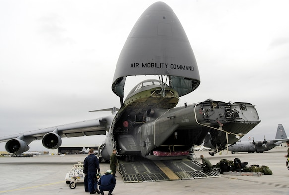 SIGONELLA NAVAL AIR STATION,  Sicily -- A Navy MH-53E Sea Dragon is unloaded from a C-5 Galaxy here March 14.  (DOD photo by Petty Officer 2nd Class James K. McNeil)