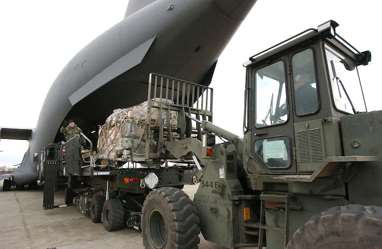 CONSTANTA, Romania - Airmen from the 349th Tanker Airlift Control Element unload a C-17 Globemaster III from McChord Air Force Base, Wash. This base in Romania is a key link in the air bridge supporting Operation Iraqi Freedom. (U.S. Air Force photo by Master Sgt. Keith Reed)