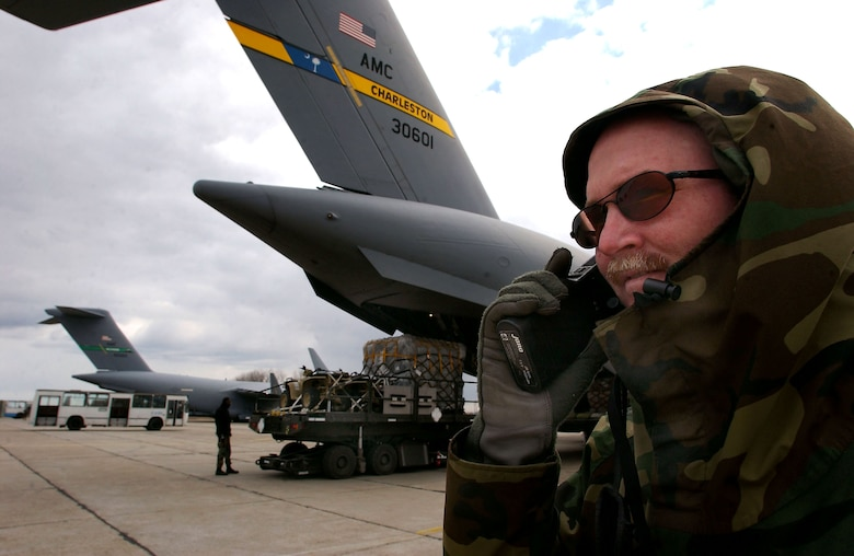 CONSTANTA, Romania -- Lt. Col Greg Staten, commander of the 349th Tanker Airlift Control Element, oversees the unloading of C-17 Globemaster IIIs from Charleston Air Force Base, S.C., and McChord AFB, Wash., on March 19. Operating 24 hours a day, the TALCE is key to maintaining troop and equipment movement for the Operation Iraqi Freedom air bridge. (U.S. Air Force photo by Master Sgt. Keith Reed)