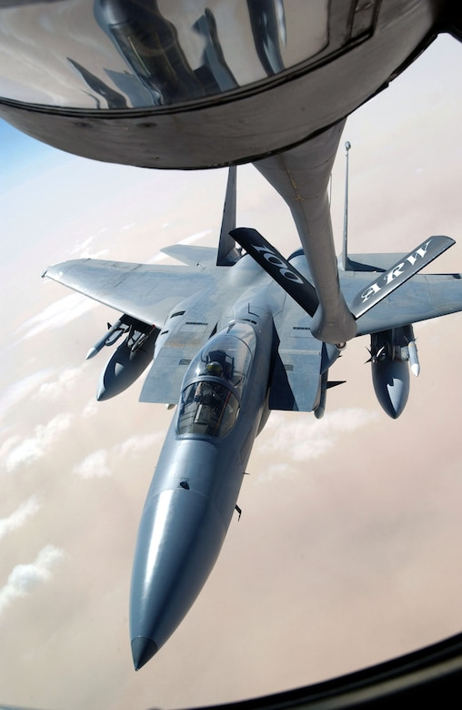 SOUTHWEST ASIA -- An F-15 Eagle from the 33rd Fighter Wing, Eglin Air Force Base, Fla., receives fuel from a tanker assigned to the 401st Air Expeditionary Wing, operating from a forward-deployed location. (U.S. Air Force photo by Master Sgt. Mark Bucher)