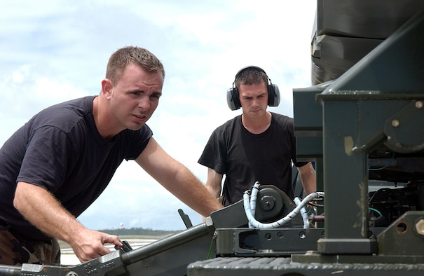 ANDERSEN AIR FORCE BASE, Guam  --  Staff Sgts. John Beldin and Landon Favors, B-52 Stratofortress weapons loaders, prepare an air-launched cruise missle for loading on a B-52 here March 20.  Aircraft and support troops from the 2nd Bomb Wing at Barksdale Air Force Base, La., are deployed as part of the 7th Air Expeditionary Wing.  (U.S. Air Force photo by Senior Airman Christina M. Rumsey)