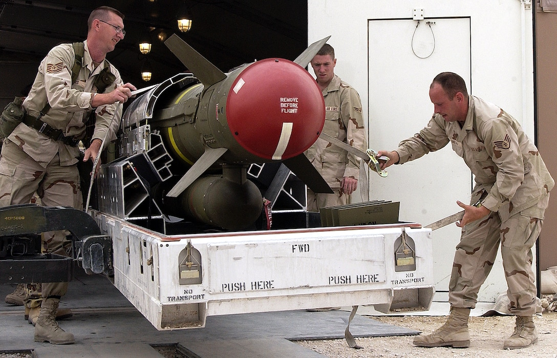 OPERATION IRAQI FREEDOM -- Members of the 379th EMXX Squadron, roll out a AGM-130 bomb to be delivered to the flight line at this forward-deployed location on March 21, 2003. The 379th Ammo squadron has built more than 5,000 bombs in the past four weeks for aircraft in support of Operation Enduring Freedom. (U.S. Air Force photo by Staff Sgt. Derrick C. Goode)