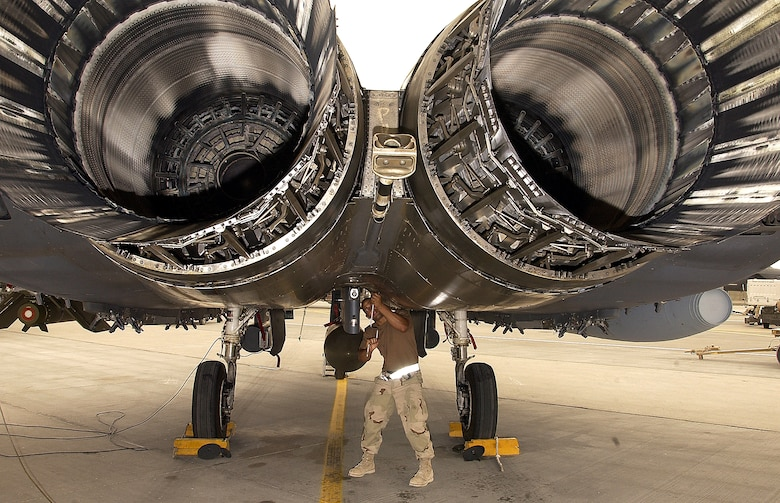 SOUTHWEST ASIA -- A crew chief from the 335th Expeditionary Fighter Squadron prepares an F-15E Strike Eagle for a mission at a forward-deployed location on March 21, 2003. The Strike Eagles from Seymour Johnson A.F.B., are deployed in support of current operations in the Middle East. (U.S. Air Force photo by Staff Sgt. Derrick C. Goode)