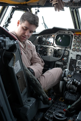 OPERATION IRAQI FREEDOM -- Capt. Jason, a B-52 pilot, checks his ejection seat and gets ready for a mission March 21. (U.S. Air Force photo by Tech. Sgt. Jason Tudor)