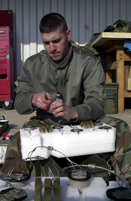 OPERATION IRAQI FEEDOM - Tech. Sgt. James Sutton, 5th Expeditionary Maintenance Squadron Munitions Flight, builds a fuze for the GBU-31 Joint Direct Attack Munition March 23. Sutton is an instructor at the Air Force Combat Ammunition Center at Beale Air Force Base, Calif. Currently the schoolhouse is closed and Ammo troops assigned to the 9th Munitions Squadron have deployed in support of Operation Iraqi Freedom. (U.S. Air Force photo by Staff Sgt. Kristina Barrett)