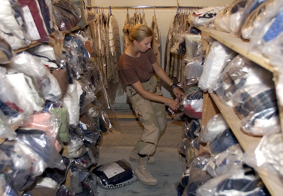 OPERATION IRAQI FREEDOM -- Staff Sgt. Jennifer Shockley, from the 379th Expeditionary Medical Squadron, voluteers at the laundry facility in her time off at this forward-deployed air base in the Middle East on March 24, 2003. Since the start of Operation Iraqi Freedom, servicemembers from different organizations have had to take over the duties of civilian personnel that are no longer permitted on base. (U.S. Air Force photo by Staff Sgt. Derrick C. Goode)
