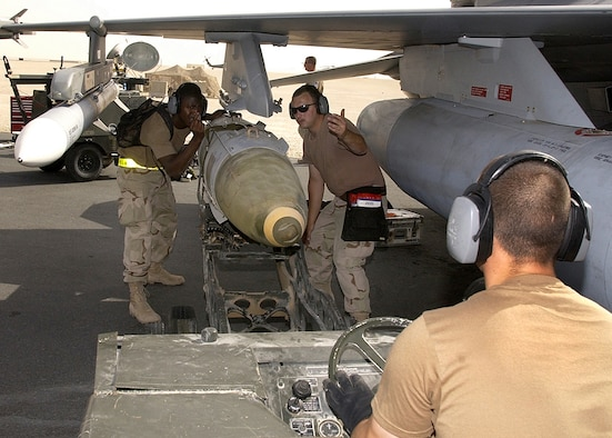OPERATION IRAQI FREEDOM -- A weapons load crew, 22nd Expeditionary Fighter Squadron, load a GBU-31 bomb on an F-16CJ from Spangdalem Air Base, Germany before a mission on March 24, 2003 The F-16CJs are assigned to this forward-deployed air base in support of Operation Iraqi Freedom. (U.S. Air Force photo by Staff Sgt. Derrick C. Goode)