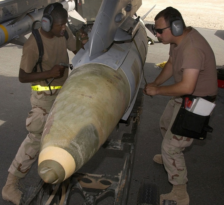 OPERATION IRAQI FREEDOM -- A weapons load crew from the 22nd Expeditionary Fighter Squadron loads a GBU-31 precision-guided bomb on an F-16 Fighting Falcon on March 24 at a forward-deployed Operation Iraqi Freedom air base. (U.S. Air Force photo by Staff Sgt. Derrick C. Goode)