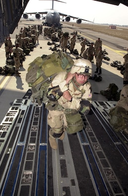 "OPERATION IRAQI FREEDOM -- A soldier boards a C-17 Globemaster III.  Nearly 1,000 ""Sky Soldiers"" of the 173rd Airborne Brigade parachuted from C-17s into the Kurdish-controlled area of northern Iraq.  This was the first combat insertion of paratroopers using a C-17.  (U.S. Air Force photo by Airman 1st Class Isaac G. L. Freeman)"