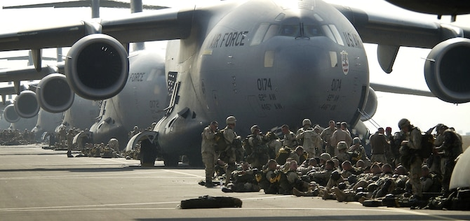 "OPERATION IRAQI FREEDOM -- U.S. Army paratroopers prepare to board a C-17 Globemaster III. Nearly 1,000 ""Sky Soldiers"" of the 173rd Airborne Brigade recently parachuted from C-17s into the Kurdish-controlled area of northern Iraq. This was the first combat insertion of paratroopers using a C-17. U.S. Air Force Tactical Air Controllers along with an Air Force Contingency Response Group were also part of the troop movement in support of Operation Iraqi Freedom. (U.S. Air Force photo by Tech. Sgt. Stephen Faulisi)"