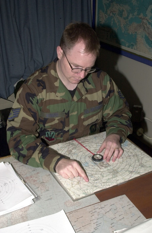 OPERATION IRAQI FREEDOM -- Staff Sgt. Mike Wimmer reads a visibility chart at a forward-deployed location.  Wimmer is weather forecaster assigned to the 457th Air Expeditionary Wing. (U.S. Air Force photo by Tech. Sgt. Jim Fisher)