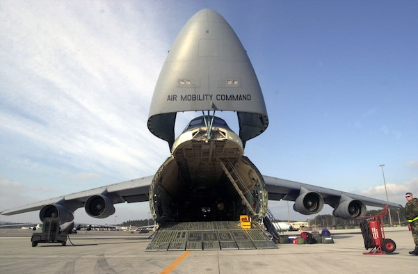 OPERATION IRAQI FREEDOM -- A C-5 Galaxy transport from the 439th Airlift Wing, 337th Air Reserve Squadron, Westover Air Reserve Base, Chicopee, Mass., sits on the ramp at Ramstein Air Base Germany while its crew prepares to upload the day's cargo in support of Operation Iraqi Freedom, March 31, 2003. The C-5 Galaxy is the largest aircraft in the Air Force inventory and is capable of delivering completely-equipped combat units, support forces and all types of supplies to any location in the world. (U.S. Air Force photo by Tech. Sgt. Cherie McNeill)