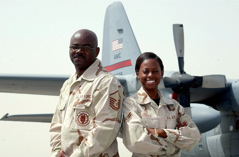 OPERATION IRAQI FREEDOM -- Master Sgt. Lorenzo Rogers, 320 EMXS, recruited Airman 1st Class Natasha Butler, 772 EAS, in July 2001.  Both are now assigned to the 463 AG, Little Rock Rock AFB, Ark., and are currently deployed together.  (U.S. Air Force photo by Staff Sgt. Pamela Smith)