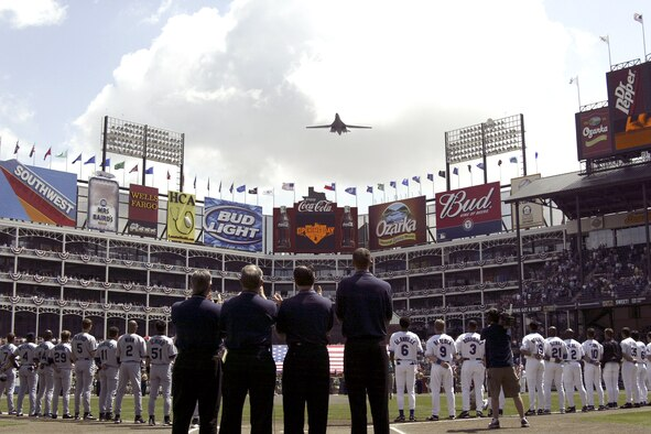 ARLINGTON, Texas -- A B-1B Lancer performs a flyover at the Texas Rangers first season home game here, April 4.  The B-1B was from the 28th Bomb Squadron at Dyess Air Force Base.  The B-1B was flown by Maj. Michael Jackon Jr., pilot, and co-pilot, 1st Lt. Jade Yim and weapons system officers, Capt. Daemon Hobbs and Capt. Scott Koeckritz.  This is the third year Dyess B-1Bs have opened the Rangers season opener at home. (U.S. Air Force photo by Staff Sgt. Adam R. Wooten)