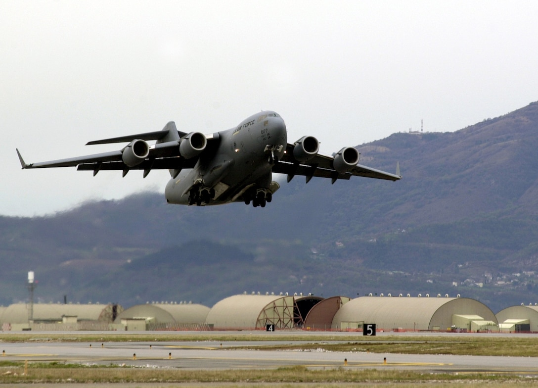 AVIANO AIR BASE, Italy  --  A C-17 Globemaster III takes off from here bound for McChord Air Force Base, Wash., after transiting through Italy.  (U.S. Air Force photo by Staff Sgt. Mitch Fuqua)