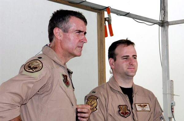 OPERATION IRAQI FREEDOM -- Lt. Col. Mike Webb and 1st Lt. Chad Martin, 332nd Air Expeditionary Wing fighter pilots, answer questions to stateside reporters during a live satellite feed from Kuwait City. (U.S. Air Force Photo by Master Sgt. Stefan Alford)