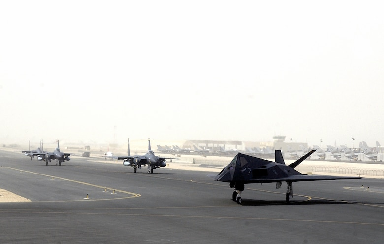 OPERATION IRAQI FREEDOM -- An F-117 from the 8th Expeditionary Fighter Squadron out of Holloman A.F.B., NM, followed by F-15s from Seymour Johnson Air Force Base, N.C., prepare to launch from a forward-deployed air base in the Middle East on April 14, 2003. The 8th EFS has begun returning to Hollomann A.F.B. after having been deployed to the Middle East in support of Operation Iraqi Freedom. (U.S. Air Force photo by Staff Sgt. Derrick C. Goode)
