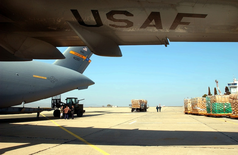 OPERATION IRAQI FREEDOM -- Airmen from the 409th Air Expeditionary Group, deployed to Camp Sarafovo, Bulgaria, palletize and load humanitarian cargo onto a C-17 Globemaster III.  The C-17 landed a Burgas Airport on its way to deliver humanitarian aid to the people of Iraq.  KC-10 Extenders from the 305th/514th Air Mobility Wing, McGuire AFB, N.J., are deployed to Burgas Airport and nearby Camp Sarafovo, Bulgaria, to support tanker operations.  Camp Sarafovo is home to the 409th Air Expeditionary Group, which is currently conducting air refueling operations with KC-10 Extender aircraft that have deployed to Burgas Airport while support operations are conducted from nearby Camp Sarafovo.  Members from various Air Force units world-wide are currently deployed with the 409th AEG in support of Operation Iraqi Freedom.  (U. S. Air Force photo by Master Sgt. Dave Ahlschwede)