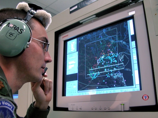 ROBINS AIR FORCE BASE, Ga. (AFPN) -- Maj. Michael Mras, sensor management officer, monitors activity while sitting at an operator workstation.  Mras is one of the many 116th Air Control Wing airmen who detect enemy ground movement and relay the information to forces on the ground and other airborne assets.  (U.S. Air Force photo by Sue Sapp)