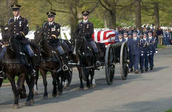 ARLINGTON, Va. (AFPN) -- The U.S. Air Force Honor Guard marches behind the caisson carrying Maj. Gregory L. Stone at Arlington National Cemetery on April 17.   Stone was the first Air Force casualty of Operation Iraqi Freedom.  He was assigned to the Idaho Air National Guard's 124th Wing.  (U.S. Air Force photo by Senior Airman Jera T. Stubblefield)