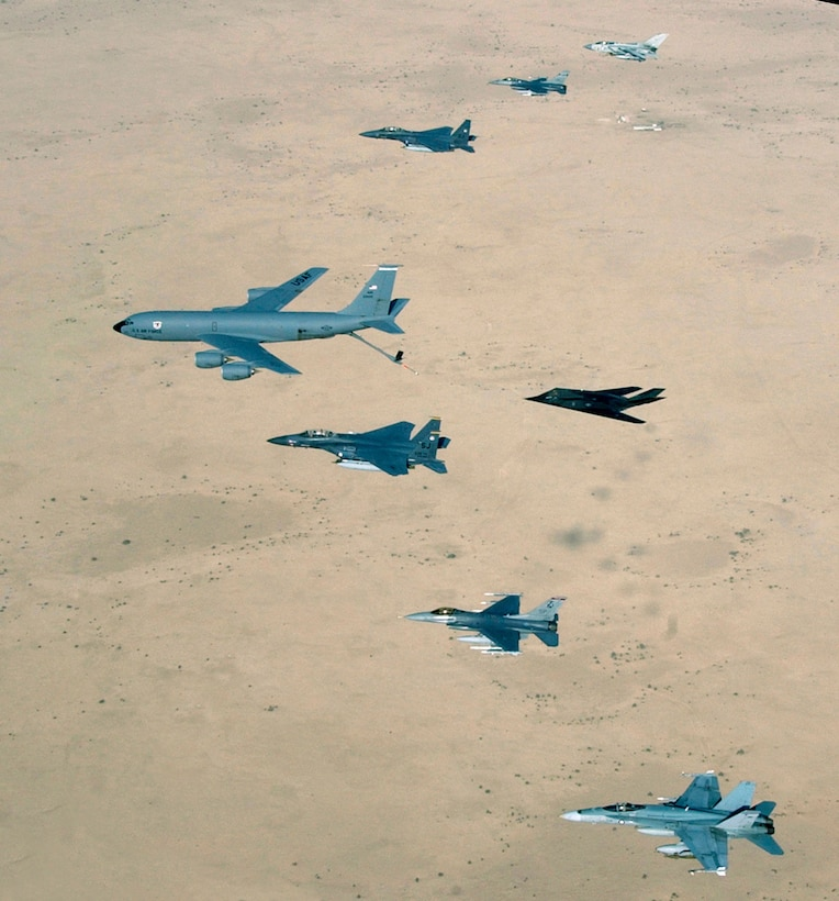 OPERATION IRAQI FREEDOM -- Aircraft of the 379th Air Expeditionary Wing and coalition counterparts stationed together in a deployed location in southwest Asia fly over the desert., April 14, 2003. Aircraft include KC-135 Stratotanker, F-15E Strike Eagle, F-117 Nighthawk, F-16CJ, British GR-4 Tornado, and Australian F/A-18 Hornet. (U.S. Air Force photo by Master Sgt. Ron Przysucha)
