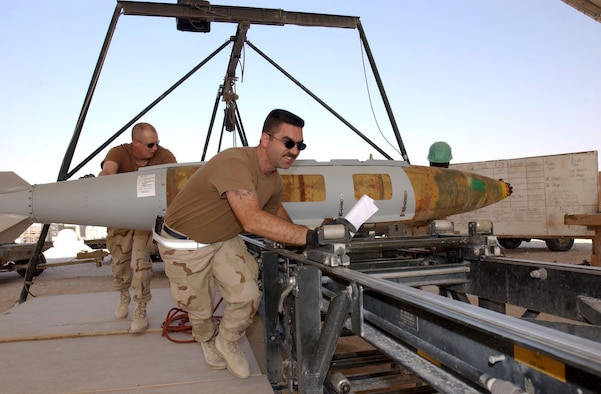 OPERATION IRAQI FREEDOM – (From left) Tech. Sgt. Chris Hickman, Master Sgt. Greg Lewis and Senior Airman Gerald Brown, all with the 379th Expeditionary Maintenance Squadron's ammo flight, move a GBU-31 Joint Direct Attack Munition into position for disassembly and shipment at a forward-deployed location.  (U.S. Air Force photo by Staff Sgt. David Donovan