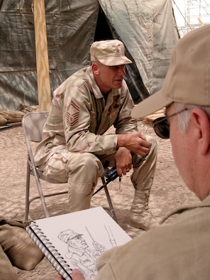 OPERATION IRAQI FREEDOM (AFPN) -- Aviation artist John Witt sketches Senior Master Sgt. Keith D. Barkema, a fuels superintendent for the 407th Air Expeditionary Group at Tallil Air Base in southern Iraq.  Witt was one of four artists visiting the austere, frontline air base on behalf of the Air Force Art Program.  The program allows artists to document and capture Air Force operations in war and peacetime.  (U.S. Air Force photo by Bob Jensen)