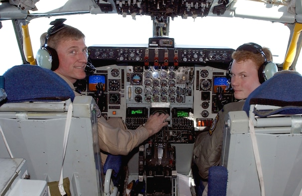 OPERATION IRAQI FREEDOM -- Col. Tony Mauer (left) and 1st Lt. Eric Adcock fly a KC-135 Stratotanker as they prepare to refuel both their brothers' aircraft.  Mauer's brother, Maj. John Mauer, is a navigator in the E-3 Sentry airborne warning and control system aircraft, and Adcock's brother, 1st Lt. Nick Adcock, is a pilot in the E-8C Joint Stars aircraft.  (U.S. Air Force photo by Master Sgt. Mark Bucher)