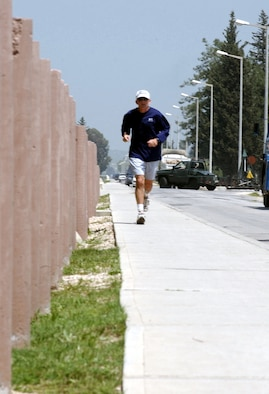 INCIRLIK AIR BASE, Turkey -- Lt. Col. Rod Matte, executive officer to the Operation Northern Watch commanding general, completes his goal of running 1,000 miles while deployed here.  Matte was part of the more than 1,400 British, Turkish and U.S. troops who were deployed to enforce the no-fly zone in northern Iraq.  (U.S. Air Force photo by Airman 1st Class Dallas Edwards)