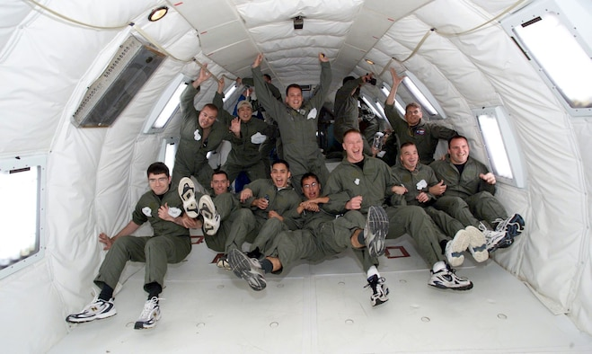 "EDWARDS AIR FORCE BASE, Calif. -- Students in the Aerospace Vehicle Test Course experience zero gravity during a ride in the NASA KC-135 also known as the ""vomit comet"".  The AVTC trains students to become space flight-test engineers.  (Courtesy photo)"
