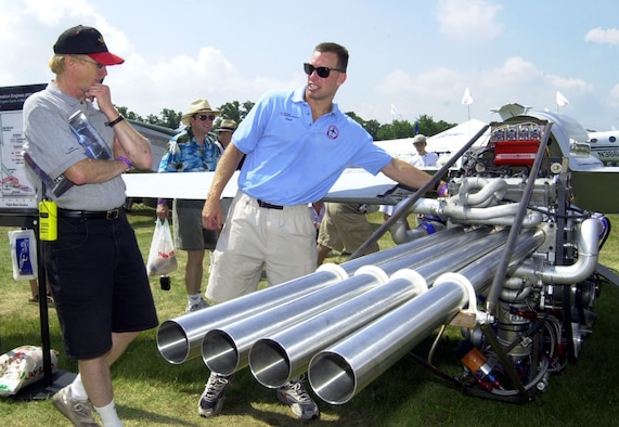 OSHKOSH, Wis. -- Dr. Fred Shauer talks to Experimental Aircraft Association's AirVenture visitors about the pulsed detonation engine the Air Force Research Laboratory from Wright-Patterson Air Force Base, Ohio, has on display.  The engine is a test bed for future engines that will be capable of powering aircraft to speeds of up to Mach 4.  (U.S. Air Force Photo by Bill McCuddy)