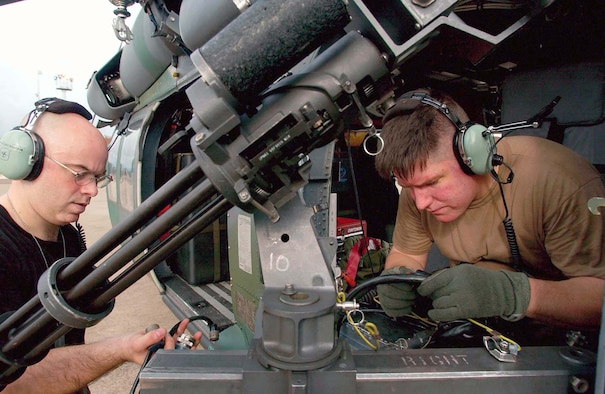 LUNGI, Sierra Leone -- Tech. Sgt. Todd Bailey (left) and Staff Sgt. Matthew Kelly work on a GAU-2 minigun mounted on an HH-60G Pave Hawk helicopter here.  They are deployed from the 85th Maintenance Squadron at Naval Air Station Keflavik, Iceland.  (U.S. Air Force photo by Tech. Sgt. Justin D. Pyle)