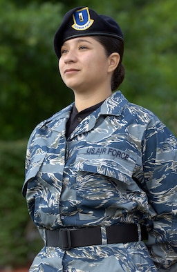 ANDREWS AIR FORCE BASE, Md. (AFPN) -- Second Lt. Arcelia Miller, from the Air Force's special security office, puts the Air Force test utility uniform through its paces at an entry control point here.  The blue, gray and green tiger-stripe camouflage ensemble includes many new features intended to increase functionality while providing a distinctive look for the 21st century airmen.  The uniforms will undergo wear-testing beginning in January 4.  Airmen from a cross section of Air Force career fields will provide feedback on the fit, durability and functionality of the proposed ensemble which will come in men's and women's cuts.  (U.S. Air Force photo by Master Sgt. Jim Varhegyi)