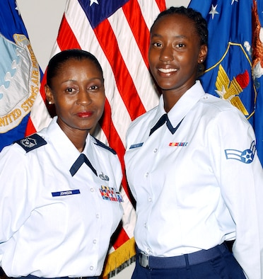 RANDOLPH AIR FORCE BASE, Texas (AFPN) -- Master Sgt. Sharita Johnson (left) and her daughter, Airman 1st Class Kareema Palmer-Johnson, were promoted together Aug. 1. (U.S. Air Force photo by Joel Martinez)