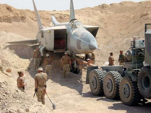 OPERATION IRAQI FREEDOM -- A search team discovers a MiG-25 Foxbat buried beneath the sands in Iraq. Several MiG-25 interceptors and Su-25 ground attack jets have been found buried at Al-Taqqadum air field west of Baghdad. (U.S. Air Force photo by Master Sgt. T. Collins)