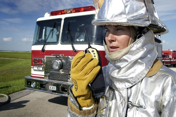 PATRICK AIR FORCE BASE, Fla. -- Staff Sgt. Suzanne Blundell, a 45th Civil Engineer Squadron firefighter, radios in to other firefighters during a training exercise.  Blundell is the only female firefighter at the base fire station.  (U.S. Air Force photo by Jim Laviska)