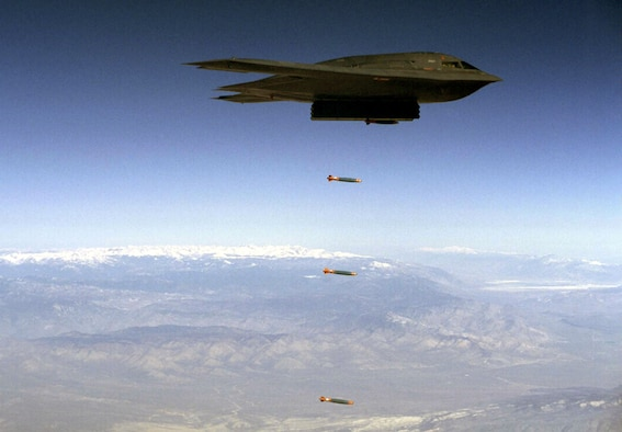 EDWARDS AIR FORCE BASE, Calif. -- A B-2 Spirit drops Joint Direct Attack Munitions separation test vehicles over Edwards in an earlier test.  On Aug. 6, a B-2 dropped 80 inert JDAMs during a test to increase the B-2's operational capability.  (Courtesy photo)