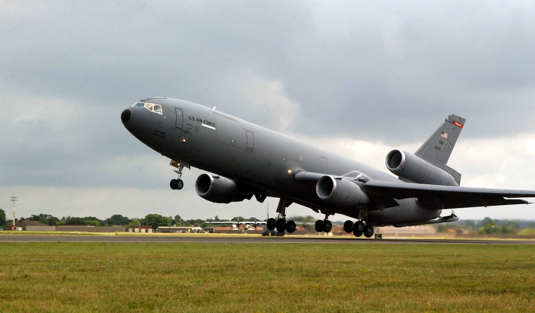 ROYAL AIR FORCE MIDENHALL, England -- A KC-10 Extender from Travis Air Force Base, Calif., takes off on a mission. The 100th Air Refueling Wing here provides operational support, and the base serves as a transiting point for personnel, aircraft and equipment destined for Europe, Africa and Southwest Asia.  (U.S. Air Force photo by Airman 1st Class Meghan Geis)