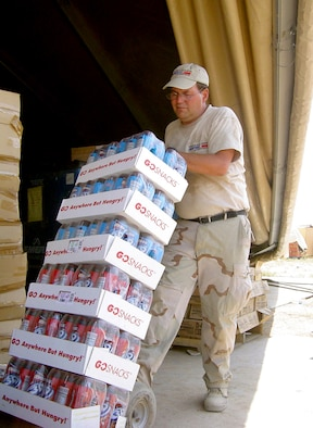KIRKUK AIR BASE, Iraq -- Tom Williams prepares to restock snacks in the base exchange here.  He is an Army and Air Force Exchange Service sales area manager from Robins Air Force Base, Ga.  Williams has been assigned here since June.  (U.S. Air Force photo by Tech. Sgt. Mark Getsy)