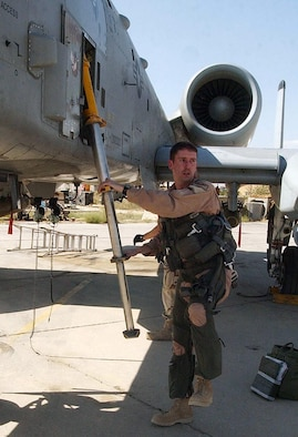 BAGRAM AIR BASE, Afghanistan  -- First Lt. Erik Axt, 81st Expeditionary Fighter Squadron, emerges from his A-10 Thunderbolt II after flying a mission here Aug. 14 supporting Operation Enduring Freedom.  (U.S. Air Force photo by Staff Sgt. Russell Wicke)