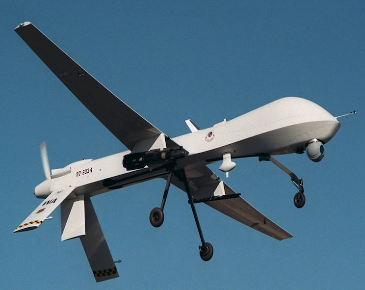 An MQ-1 Predator armed with an AGM-114 Hellfire missile flies a training mission. The MQ-1's primary mission is interdiction and conducting armed reconnaissance against critical, perishable targets. (Courtesy photo)