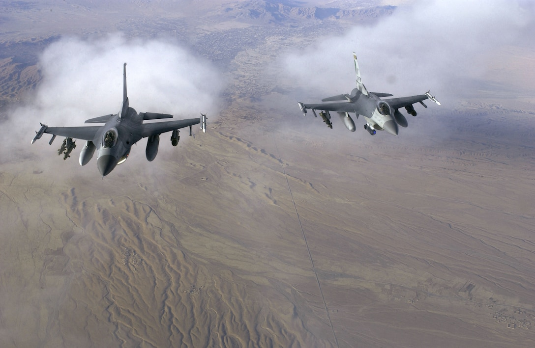OVER AFGHANISTAN -- A pair of F-16 Fighting Falcons fly a patrol mission while supporting Operation Enduring Freedom on Nov. 29.  The aircraft are from the New York Air National Guard's 174th Fighter Wing at Syracuse.  (U.S. Air Force photo by Staff Sgt. Suzanne M. Jenkins)